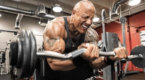 The Rock lifting weights