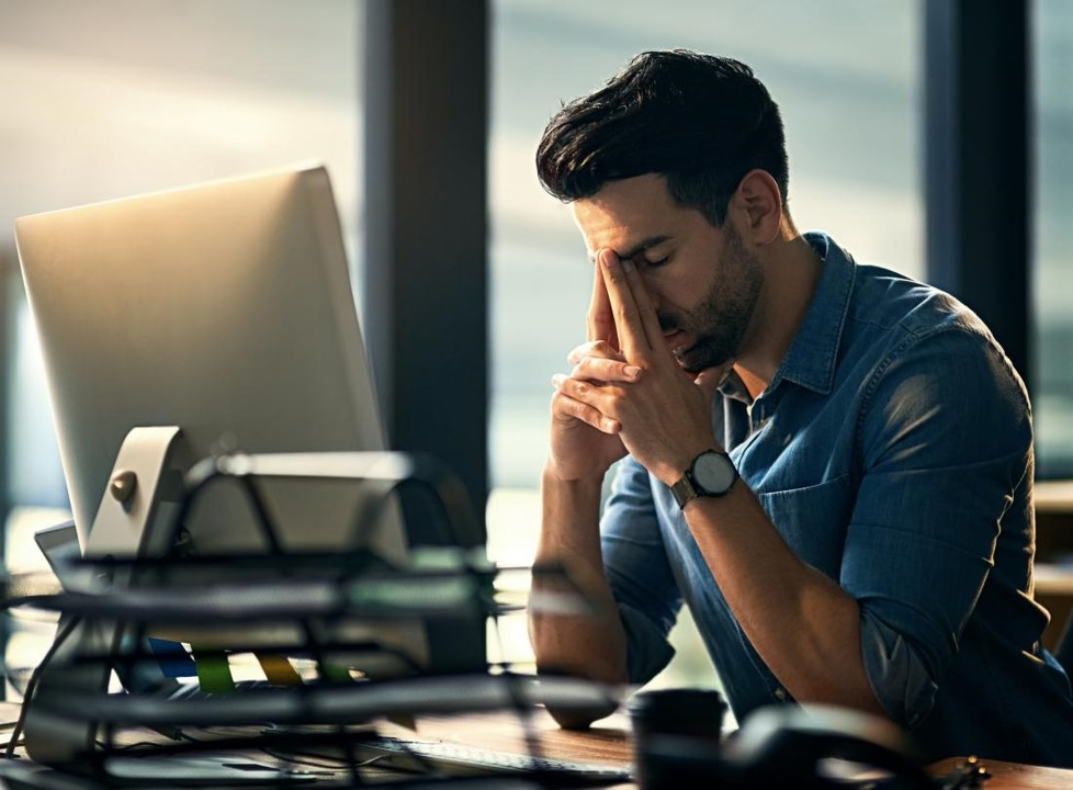 A man struggling at work because he is tired