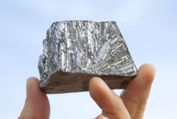 Someone holding a block of zinc